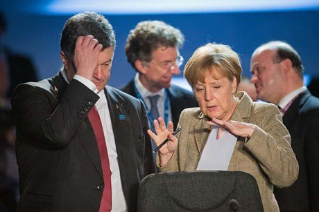 Germany's Chancellor Angela Merkel (R) talks with Ukraine's President Petro Poroshenko during a working session on Ukraine on the first day of the NATO 2014 summit at the Celtic Manor Hotel in Newport, South Wales, on Sept. 4. The NATO summit, billed as the most important since the Cold War, got under way with calls to stand up to Russia over Ukraine and confront Islamic State extremists.