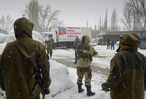 Pro-Russian soldiers welcome a Russian convoy transporting humanitarian goods to Donetsk.