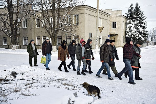 Prisoners of Russia's war against Ukraine Ukrainian prisoners from the volunteer Donbas Battalion are guarded by members of the Kremlin-supported Donetsk People's Republic as they walk on a street of the eastern Ukrainian city of Ilovaisk, controlled by the Kremlin-backed insurgents, on Dec. 4.