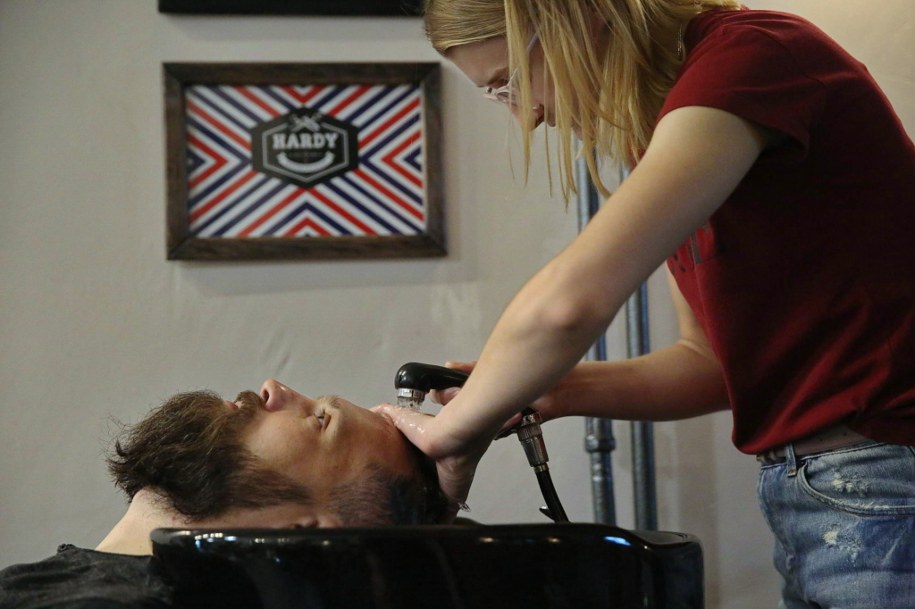 Dmytro Drizhd, 40, has his beard trimmed in Hardy barbershop in Sloviansk on Aug. 17. (Volodymyr Petrov)